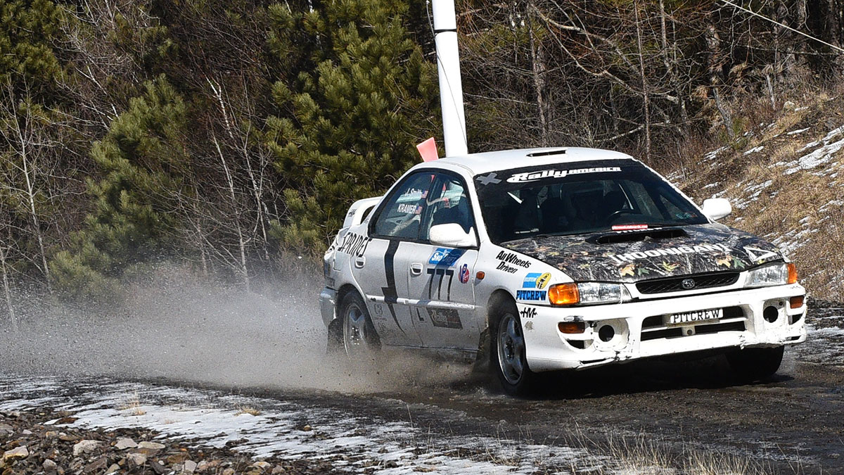 Jon Kramer (Ligonier, Pennsylvania) and co-driver Jason Smith take on the icy (then muddy) roads of the Waste Management Winter RallySprint in their 1993 Subaru Impreza. (Tim McBride)
