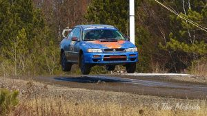 Driving a Subaru Impreza, Keck/Wimbrough grab some air at the spectator area. (TIm Mcbride)